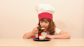 Little girl cook eat cake stock video footage