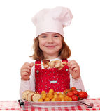 Little girl cook eat chicken meat Stock Image