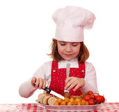 Little girl cook eat gourmet food Stock Images