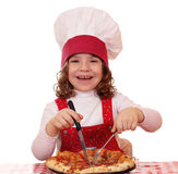 Little girl cook eat pizza Stock Photo