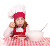 Little girl cook eat red soup Stock Image