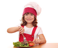 Little girl cook eat salmon seafood Royalty Free Stock Images