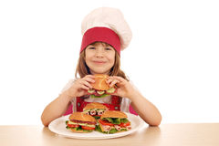 Little girl cook eat sandwich Royalty Free Stock Photography
