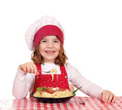 Little girl cook eat spaghetti Royalty Free Stock Images
