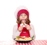 Little girl cook eat spaghetti Royalty Free Stock Photography