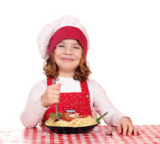 Little girl cook eat spaghetti Stock Images