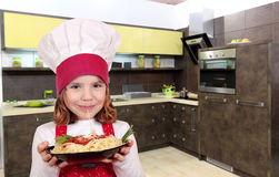 Little girl cook eat spaghetti Royalty Free Stock Image