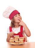 Little girl cook eat sugar Royalty Free Stock Image