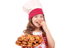 Little girl cook eating bruschette Royalty Free Stock Images