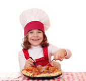 Little girl cook Stock Image