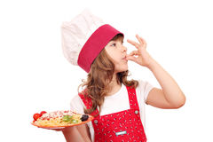 Little girl cook enjoying a spaghetti Stock Images