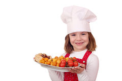 Little girl cook with food Stock Image