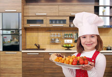 Little girl cook with gourmet food Royalty Free Stock Photos