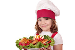 Little girl cook with gourmet food Stock Images
