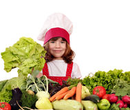 Little girl cook with green salad Royalty Free Stock Photography