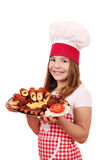 Little girl cook with grilled meat Royalty Free Stock Photography