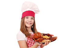 Little girl cook with grilled meat Royalty Free Stock Image
