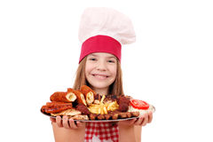Little girl cook with grilled meat on plate Stock Photo