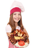 Little girl cook with grilled meat on plate Stock Photography