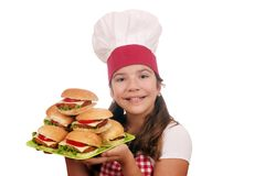 Little girl cook with hamburgers on plate Royalty Free Stock Photo