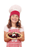 Little girl cook hold crepes filled with fruits Stock Image