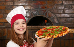 Little girl cook hold pizza Stock Photo