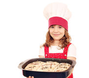 Little girl cook hold plate with bread Royalty Free Stock Images