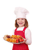 Little girl cook hold plate with gourmet food Stock Photos
