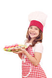 Little girl cook hold plate with macarons Royalty Free Stock Image