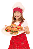 Little girl cook hold plate with sandwiches Stock Images