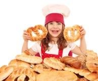 Little girl cook hold pretzels Stock Image