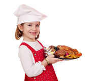 Little girl cook hold roasted chicken Stock Images