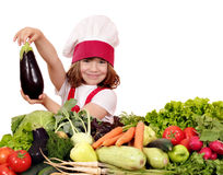 Little girl cook holding aubergine Stock Photos