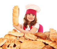Little girl cook holding bread Stock Photography