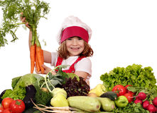 Little girl cook holding carrot Stock Photo