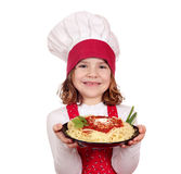 Little girl cook holding dish with spaghetti Stock Photography