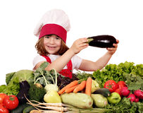 Little girl cook holding eggplant Royalty Free Stock Image