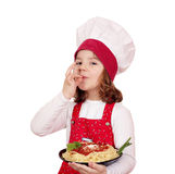 Little girl cook holding plate of spaghetti Royalty Free Stock Photo