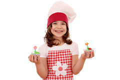 Little girl cook holding sweet muffin Royalty Free Stock Image