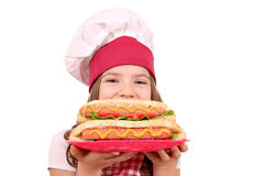 Little girl cook with hot dog Stock Image