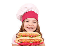 Little girl cook with hot dogs fast food Stock Images