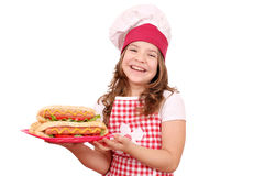 Little girl cook with hot dogs fast food on plate Royalty Free Stock Photography