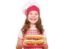 Little girl cook with hot dogs Stock Photo