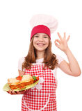 Little girl cook with Italian lasagne and ok hand sign Stock Images