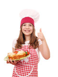 Little girl cook with Italian lasagne and thumb up Royalty Free Stock Images