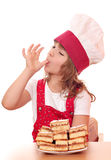 Little girl cook licks the sugar Royalty Free Stock Image