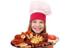 Little girl cook with meat Royalty Free Stock Photo