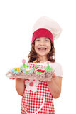 Little girl cook with muffin Royalty Free Stock Images