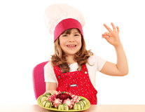 Little girl cook with ok hand sign and decorated salad Stock Photos