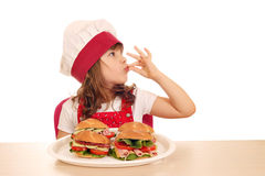 Little girl cook with ok hand sign Royalty Free Stock Images